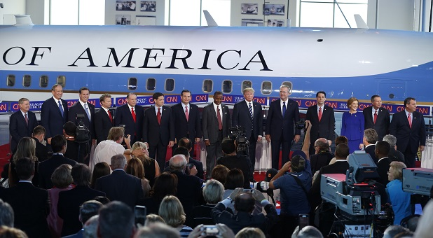 Fourteen Republican U.S. presidential candidates (L-R), U.S. Senator Lindsey Graham, former New York Governor George Pataki, former U.S. Senator Rick Santorum, U.S. Senator Rand Paul, former Arkansas Governor Mike Huckabee, U.S. Senator Marco Rubio, U.S. Senator Ted Cruz, Dr. Ben Carson, businessman Donald Trump, former Florida Governor Jeb Bush, Wisconsin Governor Scott Walker, former CEO Carly Fiorina, Ohio Governor John Kasich and New Jersey Governor Chris Christie pose before the start of the second official Republican presidential candidates debate of the 2016 U.S. presidential campaign at the Ronald Reagan Presidential Library in Simi Valley, California, United States, September 16, 2015. REUTERS/Lucy Nicholson - RTS1HC6